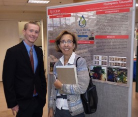 Kevin Marceskiand EcoComplex director Serpil Guran in front of Kevin's presentation poster.
