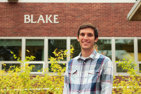 Alex Thesing SEBS'16 standing in front of Blake Hall, the home of the Department of Landscape Architecture on the George H . Cook Campus.
