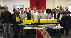 "Rutgers scientists and students gather with partners from Spain, Brazil, South Africa, and the United States at Sea Technology Services with the Rutgers ""Challenger"" glider following its recovery from the historic circumnavigation of the South Atlantic Ocean."