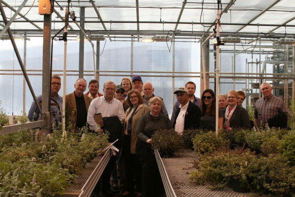 Jim Simon (far left) gave the Rutgers NJAES Board of Managers and guests a tour of his greenhouse research.