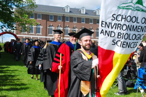The processional for SEBS Class of 2016 was led by gonfalonier Francis M. McQuarrie. Photo by Jennifer C. Simon
