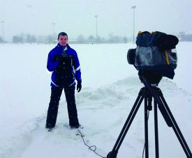Tyler Case (SEBS'15) delivering a weather report from the Rutgers campus. Photo: Courtesy of Tyler Case.