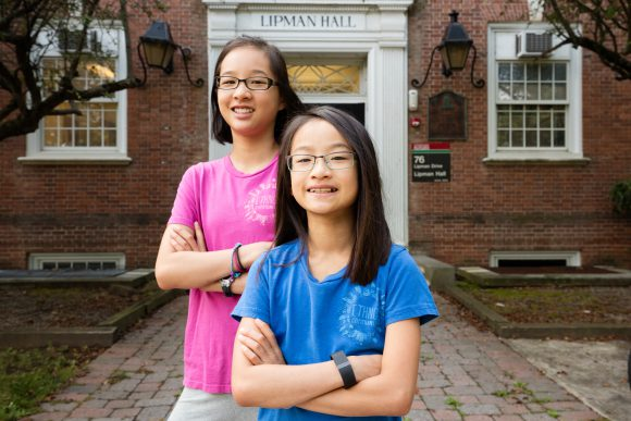 Ennyn Chiu, along with her 11-year-old sister Enna, standing in front of Lipman Hall. Photo: Michael Rayes.