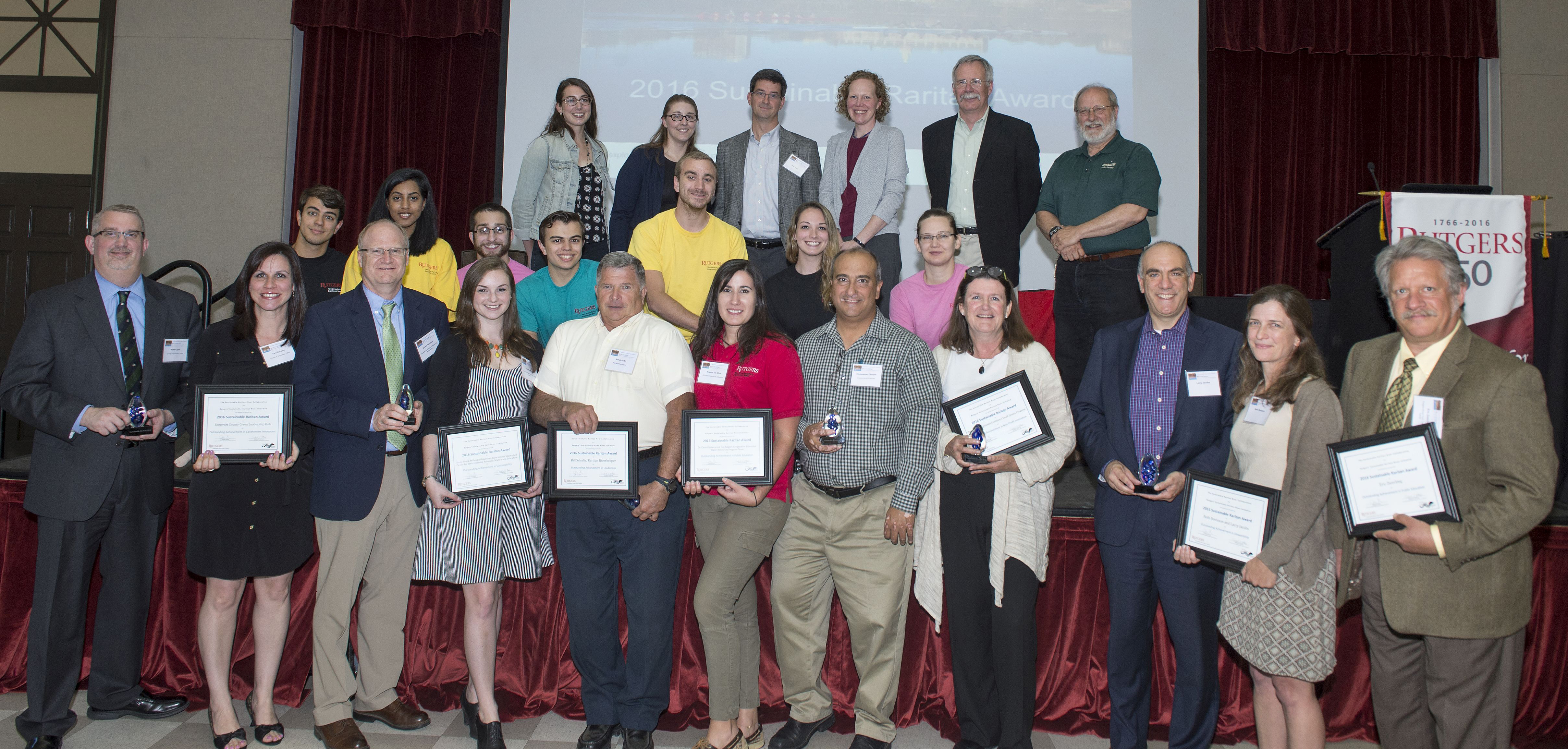 2016 awardees, left to right. Front row: Walter Lane and Tara Kenyon of Somerset County Planning Division; Jim Waltman and Kate Hutelmyer of Stony Brook-Millstone Watershed Association; Bill Schultz, Raritan Riverkeeper; Rosana Da Silva and Chris Obropta of Rutgers Cooperative Extension Water Resources Program; Julia Somers of the Highlands Coalition; Larry Jacobs and Beth Davisson; Eric Zwerling. Second row: Cody Obropta, Maithreyi Thukaram, Dominick Cardella, Tyler Obropta, Adam Cucchiara, Kaylene Campbell, Tekla Pontius-Courtney with Rutgers Cooperative Extension Water Resources Program. Third row: Brittany Musolino, Erin Stretz and Mike Pisauro of Stony Brook-Millstone Watershed Association; Debbie Mans; Bill Kibler; Michael Catania. Not shown: Candace Ashmun. Photo credit: Nick Romanenko.