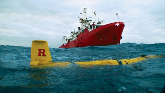 The Spanish vessel M/V Investigador approaches the Rutgers submersible robot glider Scarlet Knight off the coast of Spain in December 2009 after the glider completed its precedent-setting, 221-day underwater flight across the Atlantic Ocean. Photo: Rutgers University/Dan Crowell.