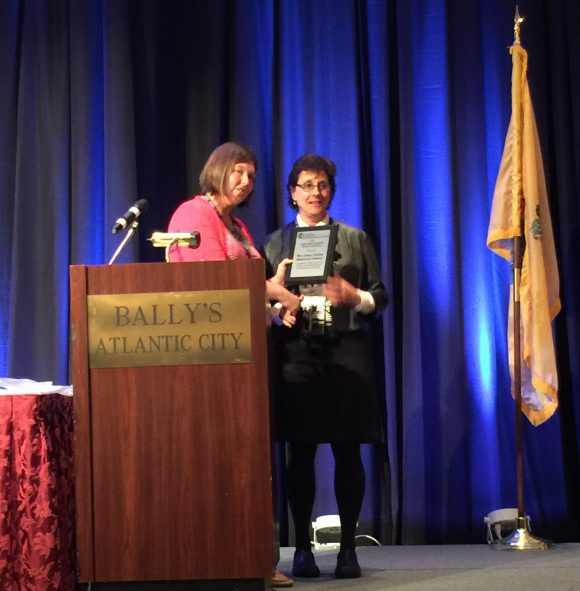 "Laura Tessieri, NJAFM's Awards and Scholarship Chair, presents the ""Outstanding Floodplain Management Award"" to Marjorie Kaplan, of the Rutgers Climate Institute, who accepted the award on behalf of the New Jersey Climate Adaptation Alliance."