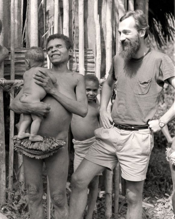 Professor George Morren with a family in New Guinea, during the late 1960s early 1970s, while he was doing his doctoral research on the Miyanmin people of New Guinea.